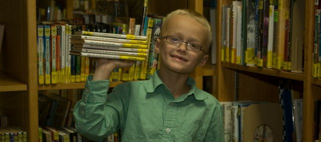 Dedicated reader Caden Phillips read 850 books as a first-grader last year, once logging 25 in one day, and has the goal of reading 1,000. With 850 books read, the 7-year-old beat the old record of his brother Blake, now a fifth-grader.