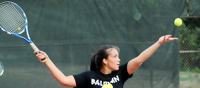 Baldwin High School senior Alison Berg prepares to serve the ball during a match Sept. 14 at the Bulldogs' home tournament. Berg played No. 2 doubles with senior Alexis Finucane. They finished runner-up with a 4-1 record.