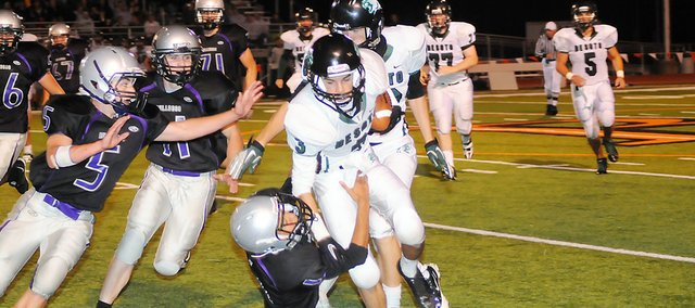 Baldwin High School senior Asher Hannon tackles a De Soto runner Friday night. De Soto won the game 28-7.