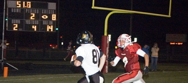 Turner High wide receiver Scott Cowan beats Tonganoxie defensive back Tyler Ford to the end zone for a late second-quarter touchdown Friday in the Chieftains' 36-6 home loss.