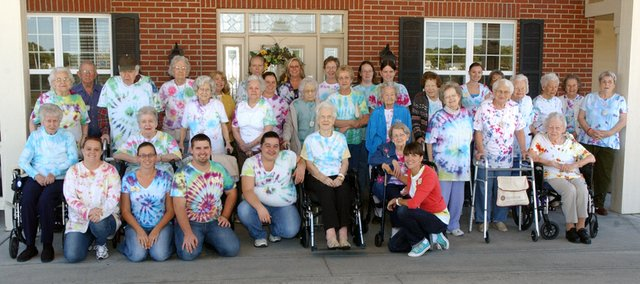 Vintage Park of Tonganoxie staff and residents dressed in tie-die T-shirts they made in anticipation of the facilities 2nd annual Bluegrass and Barbecue.