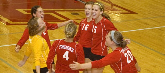 Tonganoxie High volleyball players, clockwise from top center, Kailan Kuzmic, Brooklyn Kerbaugh, Katelyn Waldeier, Sagan Scates, Megan Hummelgaard and Jenny Whitledge celebrate a score against Ottawa Saturday at the Tonganoxie Invitational. The Chieftains defeated OHS for third place.