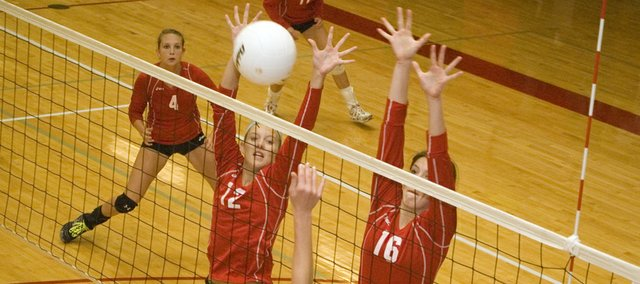 Tonganoxie High volleyball players Madee Walker and Kailan Kuzmic go up to try and block a tip against Olathe East on Saturday at the Tonganoxie Invitational. The Chieftains went 4-2 at the tournament and defeated Ottawa for third place.