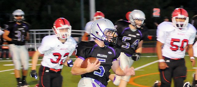 Baldwin High School sophomore Chad Berg, center, scored three touchdowns in Baldwin&#39;s 41-14 victory over El Dorado Friday night.