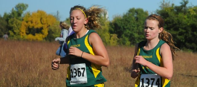 Rebecca Carroll, left, and Sara Rehm, Basehor-Linwood sophomores, compete Saturday at the CommunityAmerica Invitational in Baldwin. The BLHScross country squad split into two groups on Saturday to see differing levels of competition.