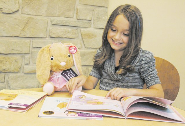 Stella Harrington, 8, a third-grader at Basehor Intermediate School, provides the voice of Abigail the Bunny in Hallmark's Interactive Storybooks & Story Buddies collection. Her parents are Brad and Carrie Harrington.