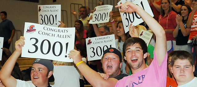 Baker University students celebrate the Wildcats' victory over Graceland University Tuesday night at the Collins Center. The victory was also No. 300 for coach Kathy Allen. She was honored after the  match with balloons and flowers as students and fans celebrated, too.