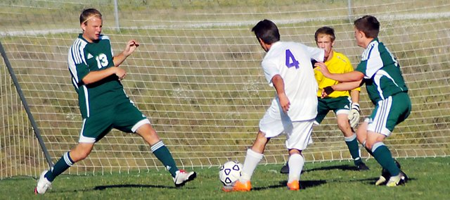 Baldwin High School senior Caleb Michels takes a shot on goal Monday against Basehor-Linwood. BHS lost the game 2-0, but beat Perry-Lecompton 2-0 on Tuesday.