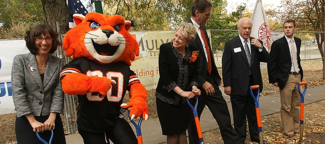 During a ground-breaking ceremony Friday at Baker University in Baldwin City, biology professor Darcy Russell, left, gets a poke from WOWzer the Baker mascot, as President Pat Long looks on with Hoot Gibson, Rich Howell and Caleb Watts. The group was marking the beginning of a project to expand science facilities at the university.