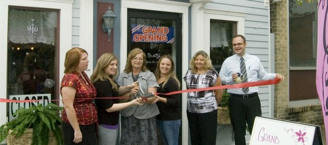 New 2 U Thrift and Gift Boutique opened Monday. At the ribbon cutting are, from left, Chamber of Commerce president Donna Hoegler, Erin Kalebaugh, owner Tammy Kalebaugh, Brande Newberry, City of Tonganoxie's Patty Hagg and Rev. Jeff Clinger of Tonganoxie United Methodist Church. Erin Kalebaugh, who also will be working at the store, and Newberry are Tammy's daughters.