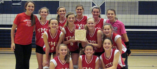 Members of the Tonganoxie Middle School eighth-grade volleyball team pose with their trophy after taking third place Saturday at the Kaw Valley League Tournament, in Shawnee. Pictured are: (front row, from left) Brooke Bolon, Taya Freeman, Mackenzie Price, (second row) Halley Calovich, Lauren Jackson, Kaitlin Hall, Emma DeMaranville, (third row) coach Erin Bates, Kassi Gratton, Emily Eberth, Cheyenne Ford, Angela Fahrety and Kennedy Morey.