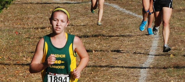 Basehor-Linwood freshman Quinnlyn Walcott pulls away from some of the competition late in the 4K girls race at the Kaw Valley League Championships. Wallcott placed fifth overall in 17 minutes, 41 seconds.