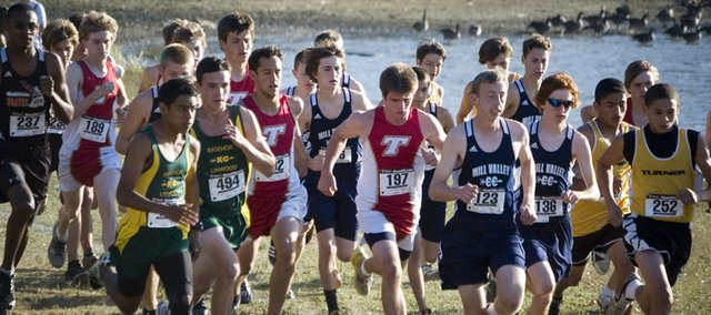 Tonganoxie High's boys cross country runners take off with other Kaw Valley League members in the opening stretch of the KVL Meet Thursday at Pierson County Park, in Kansas City, Kan. THS took second place at the league meet.