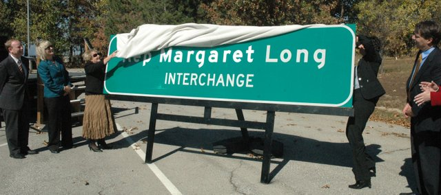 State officials unveil the new sign Thursday designating the interchange at Kansas Highway 7 and US-24/40 as the Rep. Margaret Long Interchange. The former Wyandotte County legislator represented the 38th District for four years beginning in 1998 and then the 36th District for the following seven years. Pictured from the left are Joe Reardon, mayor and CEO of the Unified Government; Sen. Kelly Kultala; Long; Deb Miller, Kansas secretary of transportation; and Lt. Gov. Jeff Colyer.