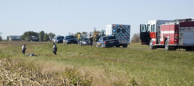 Leavenworth County Sheriff's officials work the scene of a motorcycle accident that occurred about 10 a.m. Thursday, Oct. 13, 2011, about a mile south of Tonganoxie on U.S. Highway 24-40. The bike's driver, Eldon Barrett of Parker, was taken to Kansas University Hospital by Leavenworth County Emergency Medical Services after the wreck. Barrett lost control of the bike and hit the ditch, which caused the bike to travel about 20 yards before coming to rest, according to two others who were riding with him.