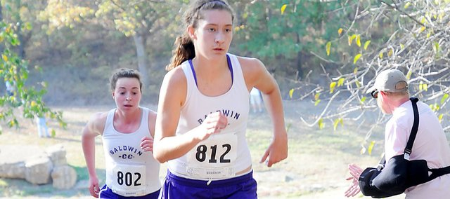 Baldwin High School sophomore Katie Jones and junior Kaitlyn Barnes compete at the Frontier League cross country meet Thursday at Rim Rock Farm. Jones and Barnes finished second and sixth, helping the Bulldogs win the girls' team title. The BHS boys' squad finished runner-up to De Soto.