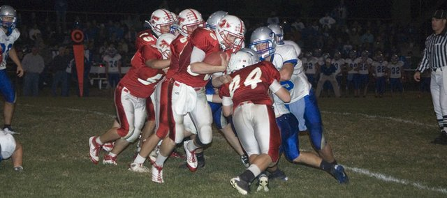 Tonganoxie High senior running back Derek Lingo tries to break a run to the outside as Shane Levy picks up a block Friday night at Beatty Field. The Chieftains lost to Perry-Lecompton, 54-7, in a district opener.