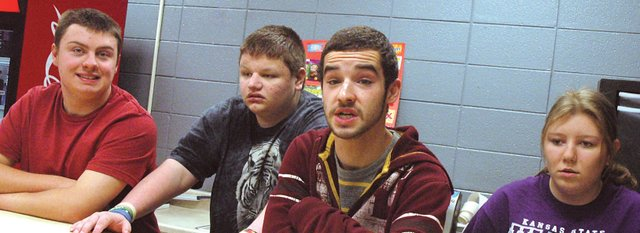 Four special education students at Bonner Springs High School are developing job skills through this year's new class, applied business development. The class meets almost daily in The Brave Cave, BSHS' new coffee shop and store. Pictured are, from left, special education students Cody Crider, Sean Holley, Philip Holcomb and Erin Walters.