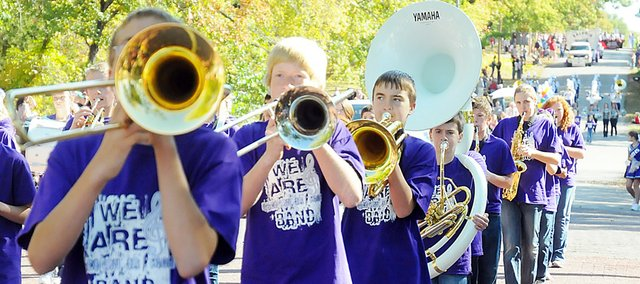 Members of the Baldwin Junior High School band perform while marching in the Maple Leaf Festival parade Saturday morning.