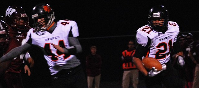 Bonner Springs running back Jared Knernschield looks for room to run during the Braves' 49-14 victory against Washington.