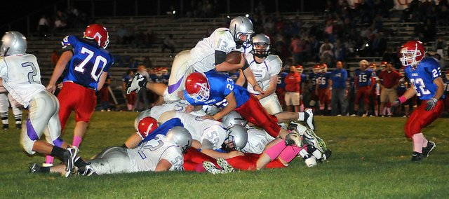 Baldwin High School junior Tyler Cawley dives over the pile and into the end zone right before halftime, giving BHS a 28-6 lead at the break. The Bulldogs went on to beat the Chargers 42-28 and earn a berth into the Class 4A state playoffs.
