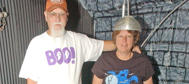 Rick and Kathy Bowen are preparing for their Halloween Bowen Bash at their homestead east of Tonganoxie that will both spook and indulge their guests. The couple annually invite about 80 relatives and friends for an evening of chills, including a haunted barn that this year will include the electric chair Kathy is strapped into, and tables filled with food.