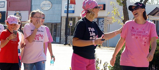 Participants in Sunday's Baldwin City Recreation Commission Breast Cancer Awareness Walk/Run share laughs as they walk to raise money and build awareness of the disease.