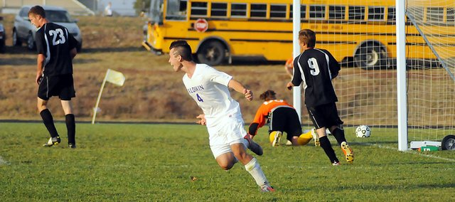 Baldwin High School senior Caleb Michels celebrates after scoring a goal Tuesday. Michels' goal broke a scoreless tie late in the second half. He later scored another goal as the Bulldogs beat Paola 2-0 in its opening regional game.