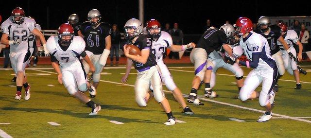 Baldwin High School sophomore Chad Berg (No. 5) runs through traffic as he makes a 68-yard touchdown run Thursday night. BHS lost the game, 28-14, to rival Eudora.