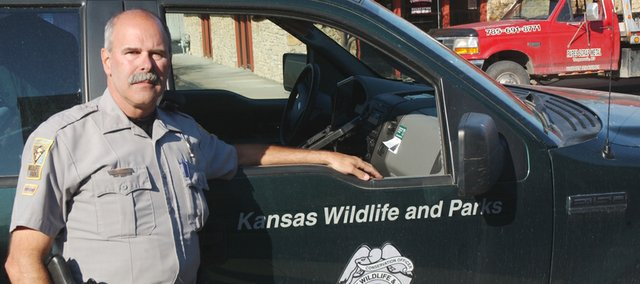 Kansas Department of Wildlife, Parks and Tourism game warden Glenn Cannizzaro compares his job to that of a basketball referee or baseball umpire, except that he works to ensure hunters and fishermen play by the rules.