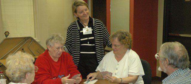 "Gretchen Lister, center, chats with members at the Bonner Springs Senior Center Tuesday as they play a game of ""catch."" Lister took over as director of the senior center this week."