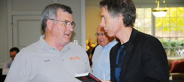 Baldwin City resident David Reed, left, talks with James Houston Turner during the hometown author's book signing last month at Baker University, his alma mater.