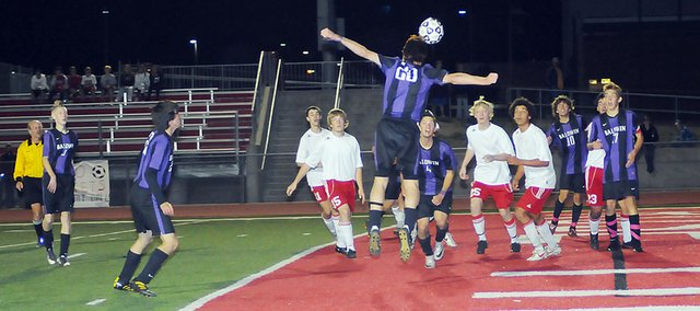 Baldwin High School junior Austin Kraus heads a ball toward the Rose Hill goal late in Monday's state playoff contest. BHS lost 3-0 to the Rockets, finishing its season with a 14-4-1 record.