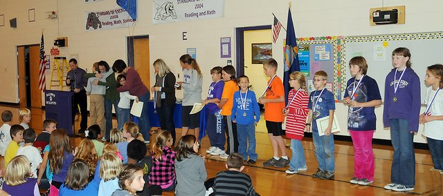Students who attended Vinland Elementary School last year receive their medals and certificates during Friday&#39;s assembly at Baldwin Elementary School Intermediate Center.