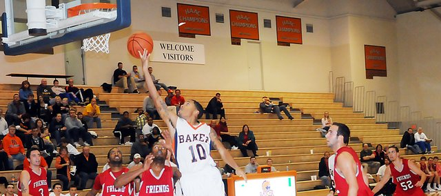 Baker University junior Jordan Honore (No. 10) glides in for a layup during the second half of Tuesdays home-opening contest. The Wildcats defeated Friends University 76-65.
