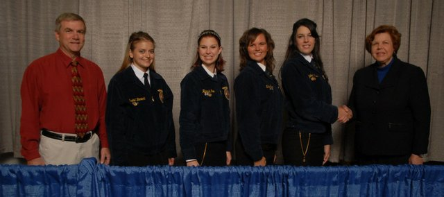 The Tonganoxie High FFA horse judging team was recognized at a national event this past month in Indianapolis in conjunction with the National FFA Convention, which takes place each year there. Pictured, from left, are THS FFA adviser Randy Kraft, Rachel Bieniecki, Hannah Gee, Nikki Gee and Tayler Miles.