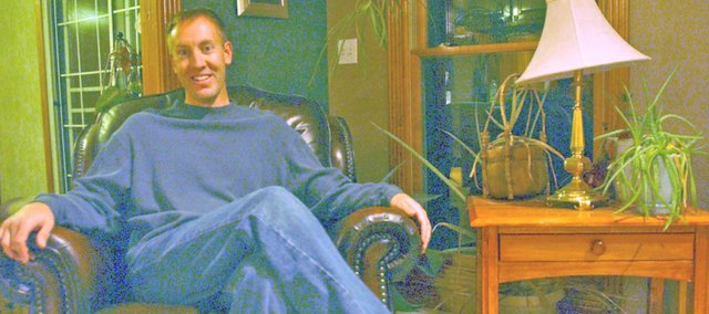 Tony DeRossett relaxes at his rural Tonganoxie home after a day delivering mail in Bonner Springs, during which he often takes calls as president of Kansas Hunters Feeding the Hungry, an organization that makes deer hunters' harvest available to food pantries.