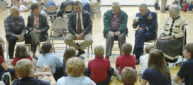 Students at Hope Lutheran School sit and listen to veterans during a question-and-answer session after the school's fifth-annual Veterans Day program.
