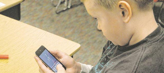 Fourth-grader Trey Mouldon plays a multiplication game on an iPod Touch at Bonner Springs Elementary School. Teachers at all Bonner Springs-Edwardsville district elementary schools have been finding ways to incorporate the new Touches into lesson plans.