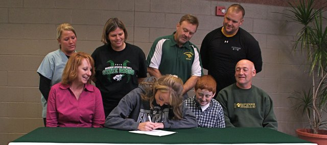 Hannah Tush, Basehor-Linwood senior softball player, signed a letter of intent to play college softball at Eastern New Mexico University. Pictured at the signing ceremony on Nov. 9 are, from left, front row: Angie Tush, mother; Hannah Tush; Timothy Tush, brother; and Thomas Tush, father; and, standing: BLHS assistant coach Terra Nichols, BLHS head coach Susan Mayberry, BLHS athletics director Joe Keeler and strength and conditioning coach Ross Schwisow.