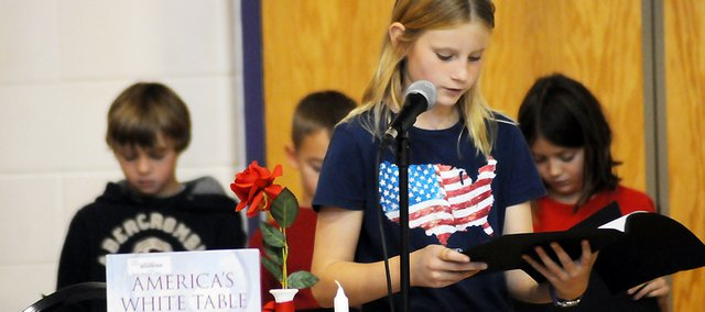 "Paige Ellis, a Baldwin Elementary School Intermediate Center fifth-grader, recites one of her lines from ""America's White Table"" during the school-wide Veterans Day ceremony Friday."