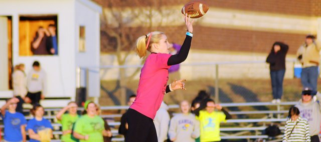 Baldwin High School's Lakyn Clark passes the football as the senior team quarterback in the school's annual powderpuff football competition. Clark guided the seniors to the championship over the other BHS classes.