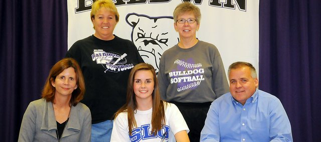 Baldwin High School senior Madeline Brungardt, seated center, signed a letter of intent Monday to play softball for Saint Louis University. She is seated with her parents, Heather and Matt Brungardt. Standing are BHS coaches Ginger Crist and Ginny Honomichl.