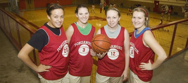 Tonganoxie High School basketball seniors hope to lead a breakthrough season this year in the Kaw Valley League. Pictured, from left, are seniors Tavia Brown, Haley Smith, Amanda Holroyd and Parker Osborne.