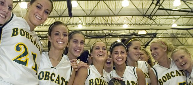 The Basehor-Linwood girls basketball team celebrates with its Class 4A substate championship plaque during the 2007-08 season. Four BLHS seniors from that team — Cassie Lombardino, Michelle Chrisman, Brooke Sanders and Ashley Jeannin — went on to play college basketball.