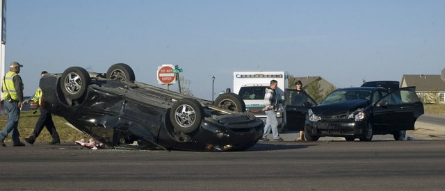 Officers investigate the scene of a rollover accident on U.S. Highway 24-40 in Tonganoxie on Wednesday, Nov. 23.