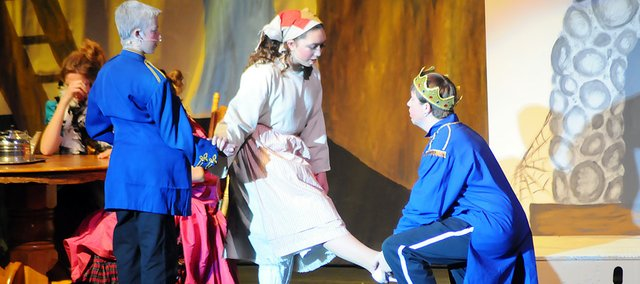 Benjamin Foster as Prince Christopher fits the match-making slipper on Cinderella (Madelynn Knisley) in the BHS fall musical performance of the Walt Disney take on the fairy tale. It was the first musical performed in the new Performing Arts Center.