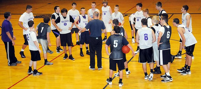 Baldwin High School boys' basketball coach Dustin Leochner, center, talks to his team during practice Tuesday evening. Leochner is in his first year as a head coach at BHS. The Bulldogs play their first game at 7:30 p.m. Friday in the Baldwin Junior High School gymnasium.