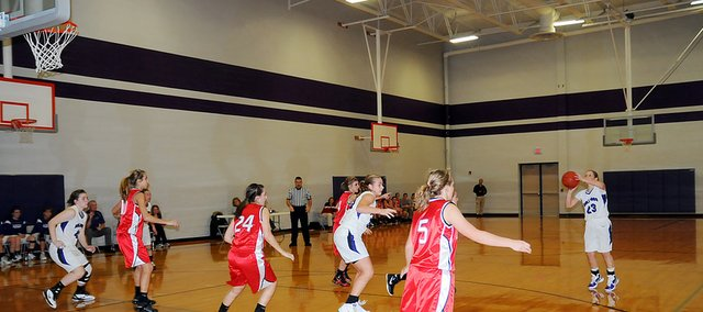 Baldwin High School junior Kailyn Smith sinks a three-pointer Tuesday night, helping Baldwin cruise to a 48-24 victory against Anderson County. With the win, Baldwin advances to the championship game of the Bulldog/Wildcat Classic.