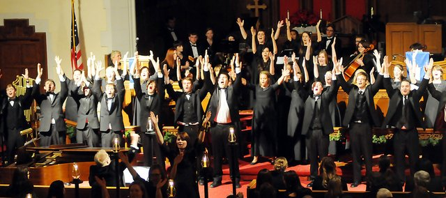 "Baker University's concert choir sings and dances to the musical piece ""Babethandaza"" during Sunday's 81st Annual Candlelight Vespers. Kelley Bethell-Smith was the choreographer of the musical number. The annual holiday concert was a big hit again this year."